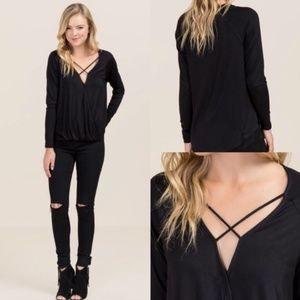 Black long sleeve, criss-cross front shirt, M